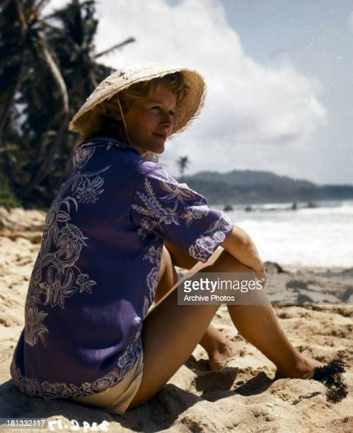 Virginia McKenna sits on the beach in a scene from the film 'Storm Over Jamaica' 1958