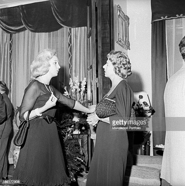 Virginia Mondadori talking to a woman at the party in honour of German writer Alfred Andersch and French writer Michel Butor She's Italian publisher...