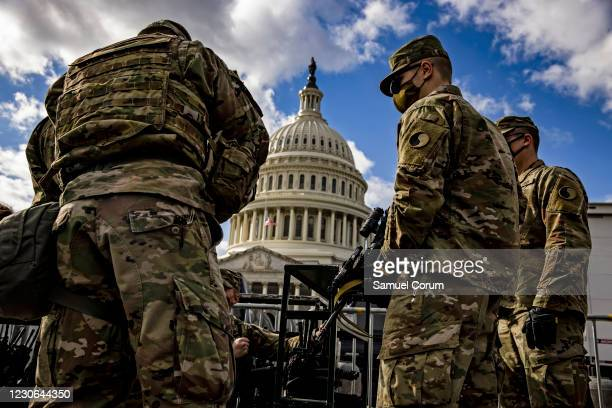 Virginia National Guard soldiers are issued their M4 rifles and live ammunition on the east front of the U.S. Capitol on January 17, 2021 in...