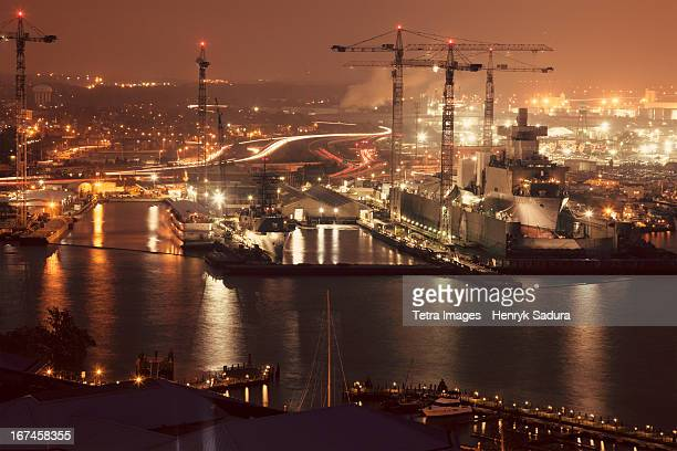 usa, virginia, norfolk, cityscape with cranes at night - norfolk virginia stock photos and pictures
