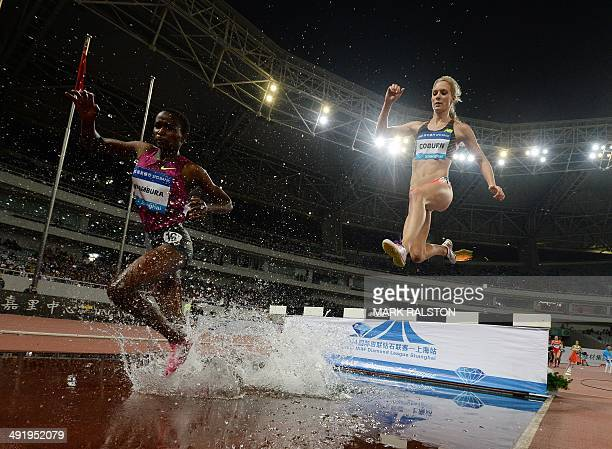 Virginia Nyambura of Kenya and Emma Coburn of the US compete in the women's 3000m steeplechase event at the Diamond League athletics meeting in...
