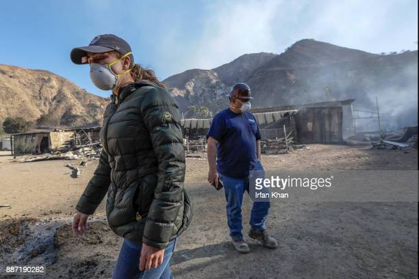 Virginia Padilla left and her brother Mike Padilla assess their Padilla Ranch on Little Tujunga Road where 29 horses perished in Creek Fire yesterday...