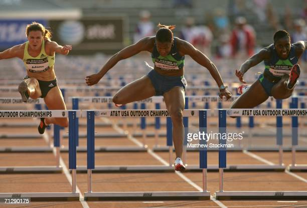 Virginia Powell leads Damu Cherry and Jenny Adams over the last hurdle on her way to winning the women's 100 meter hurdle final on the third day of...