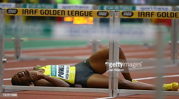 Virginia Powell of USA lies on the track after falling in the women's 100m Hurdles during the IAAF Golden League at the Stade de France on July 6...