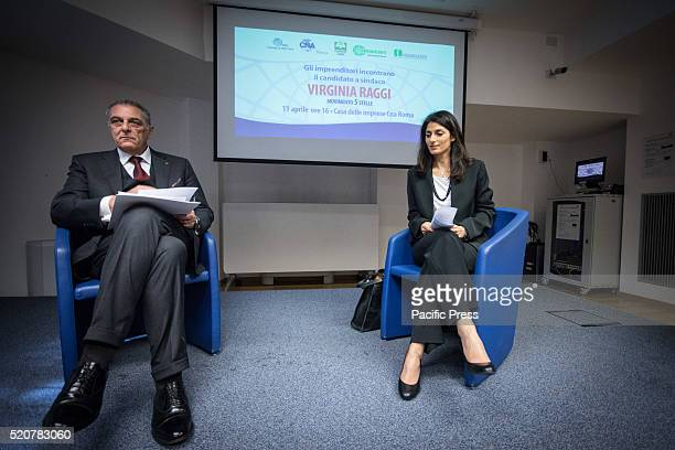 Virginia Raggi and Enrico Colombi during meeting with the entrepreneurs of CNA