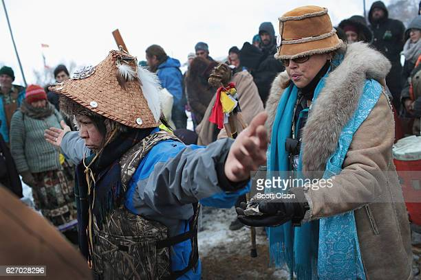 Virginia Redstar of the Colville tribe in Washington state is welcomed after traveling from the headwaters of the Missouri River in a dugout canoe to...