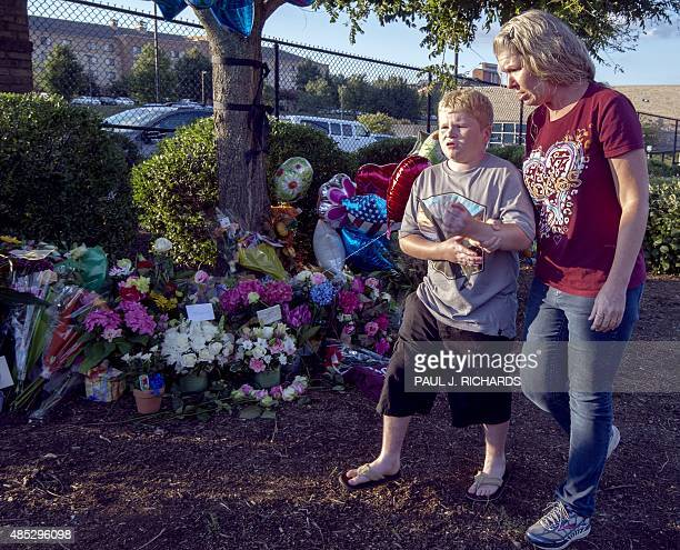 Virginia residents pay their respects at a makeshift memorial for reporter Alison Parker and cameraman Adam Ward at the gate of WDBJ television...