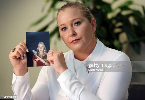 Virginia Roberts holds a photo of herself at age 16 when she says Palm Beach multimillionaire Jeffrey Epstein began abusing her sexually