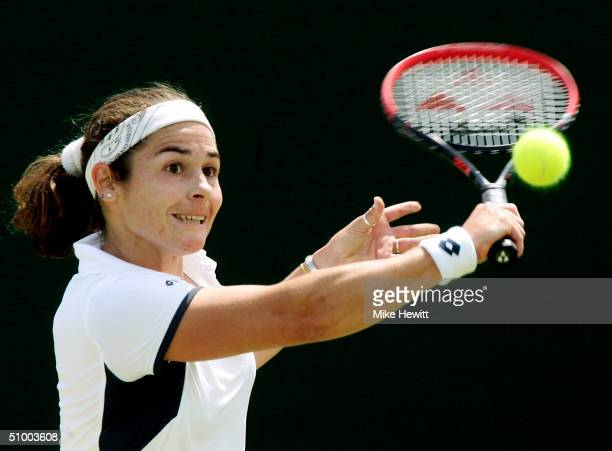 Virginia Ruano Pascual of Spain in action during her third round match against Silvia Farina Elia of Italy at the Wimbledon Lawn Tennis Championship...