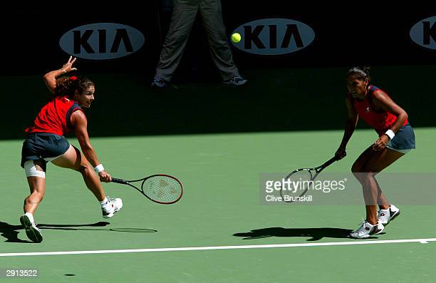 Virginia Ruano Pascual of Spain in action with Paola Suarez of Argentina during the Womens Doubles Final match against Svetlana Kuznetsova of Russia...