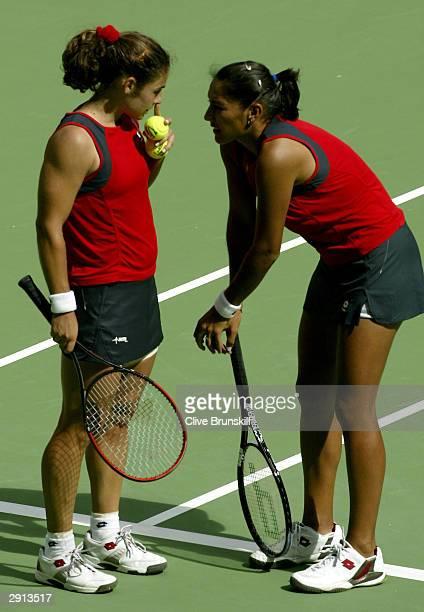 Virginia Ruano Pascual of Spain talks tactics with Paola Suarez of Argentina during the Womens Doubles Final match against Svetlana Kuznetsova of...