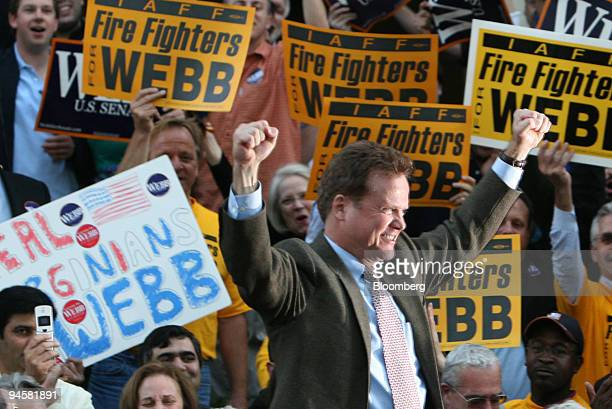 Virginia Senator Elect James Webb waves his fists in celebration as he arrives to speak at a victory rally in Arlington Virginia Thursday November 9...