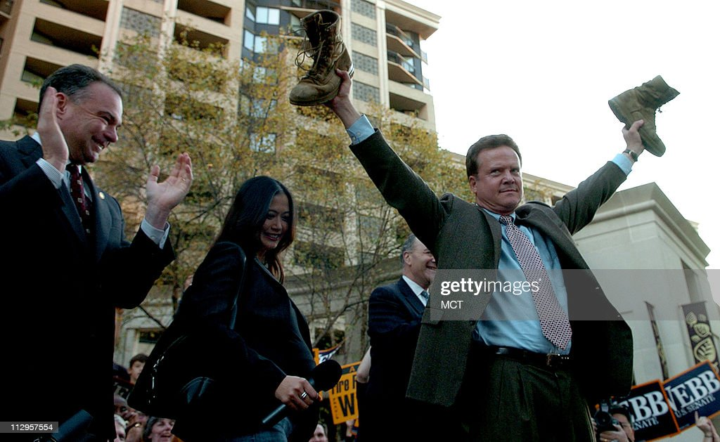 Virginia Senator-elect Jim Webb holds his son's combat boots : News Photo