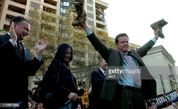 Virginia Senatorelect Jim Webb holds his son's combat boots during a victory rally in Arlington Virginia Thursday November 9 2006