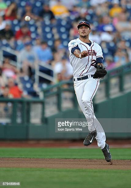 Virginia shortstop Daniel Pinero throws out runner during the College World Series game between the Virginia Cavaliers and the Florida Gators at TD...