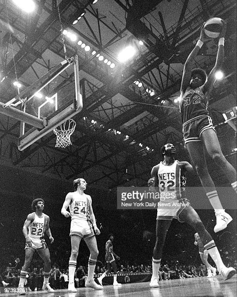 Virginia Squires Julius Erving grabs rebound against the New York Nets and Rick Barry during Game 3 of the ABA semifinal playoffs at Nassau Coliseum
