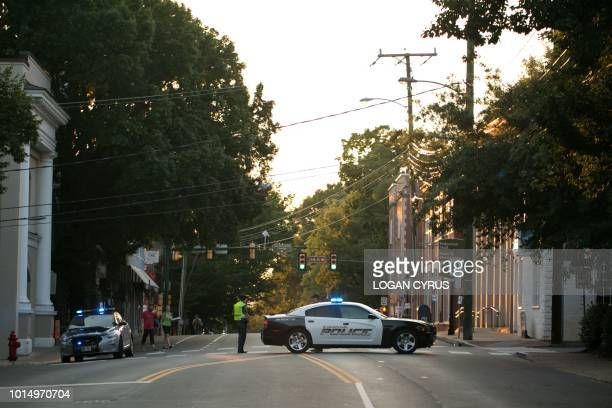 Virginia State and local police officers block off cross streets in Charlottesville Virginia on August 11 in anticipation of the year anniversary of...