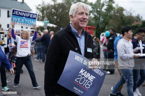 Virginia State Attorney General Mark Herring participates in the annual Haymarket Day parade October 20 2018 in Haymarket Virginia Democratic US...