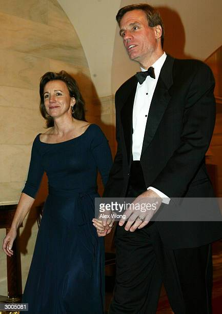 Virginia State Governor Mark Warner and his wife Lisa Collis arrive for a dinner hosted by President George W Bush and first lady Laura Bush February...