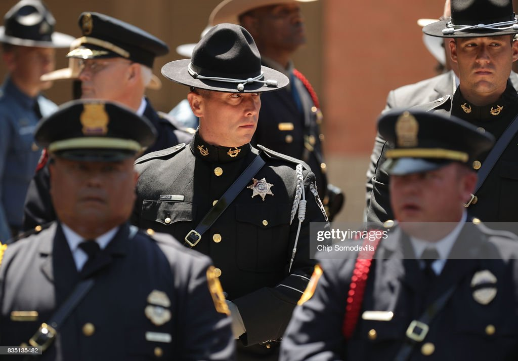 Virginia State Police and other law enforcement officers wait outside Saint Paul's Baptist Church following Trooper-Pilot Berke M.M. Bates's funeral August 18, 2017 in Richmond, Virginia. Bates and Lieutenant Pilot Jay Cullen were killed when their Bell 407 helicopter crashed into a wooded area while they were monitoring the civil unrest during the white supremacy 'Unite the Right' rally August 12 in Charlottesville, VA.
