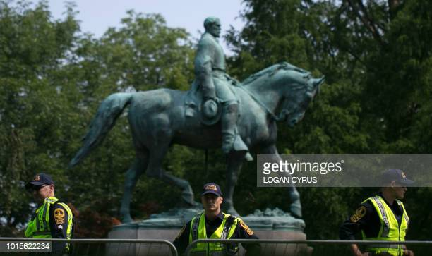 TOPSHOT Virginia State Police guard the statue of Confederate Robert E Lee on August 12 2018 in downtown Charlottesville Virginia on the oneyear...