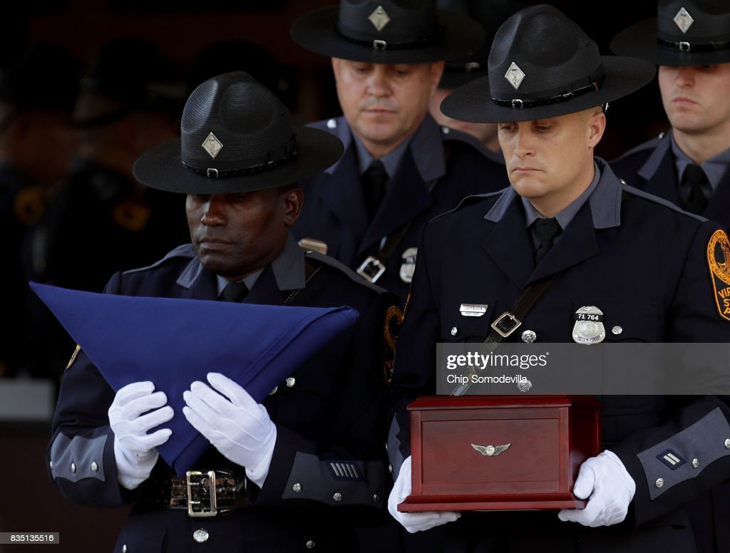 A Virginia State Police honor guard carry the urn box with the remains of Trooper-Pilot Berke M.M. Bates's funeral out of Saint Paul's Baptist Church August 18, 2017 in Richmond, Virginia. Bates and Lieutenant Pilot Jay Cullen were killed when their Bell 407 helicopter crashed into a wooded area while they were monitoring the civil unrest during the white supremacy 'Unite the Right' rally August 12 in Charlottesville, VA.
