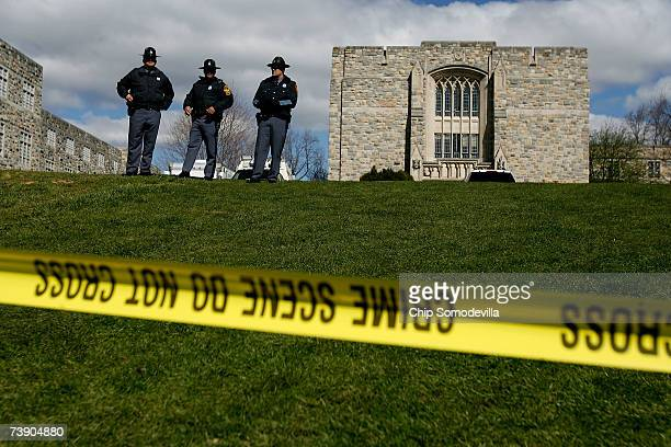 Virginia State Police stand guard outside Norris Hall where 31 people were shot and killed a day earlier on the campus of Virginia Tech April 17 2007...