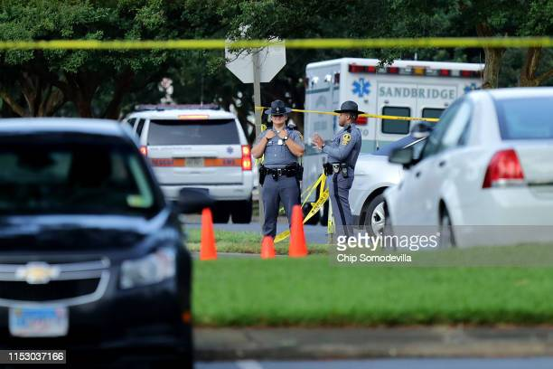 Virginia State Police stand watch at the scene of a mass shooting at the Municipal Center June 01 2019 in Virginia Beach Virginia The names of the 12...