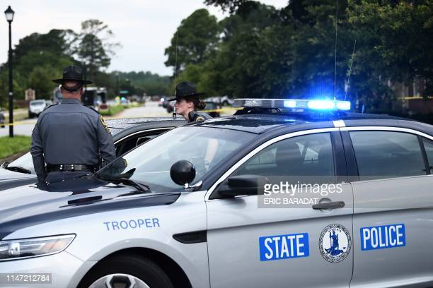 Virginia State Troopers guards a roadblock on June 1 at the scene of the mass shooting in the Virginia Beach Municipal center in Virginia Beach...