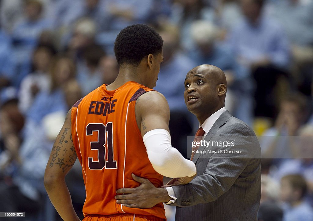 Virginia Tech coach James Johnson talks with Jarell Eddie (31) during the first half against North Carolina at the Smith Center in Chapel Hill, North Carolina, Saturday, February 2, 2013. North Carolina won in OT, 72-60.