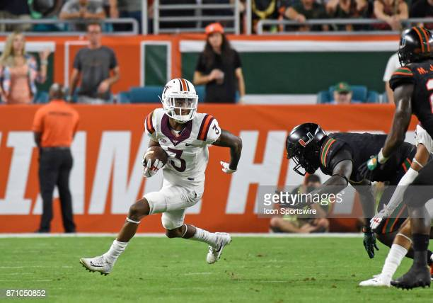 Virginia Tech defensive back Greg Stroman returns a punt during an NCAA football game between the Virginia Tech Hokies and the University of Miami...