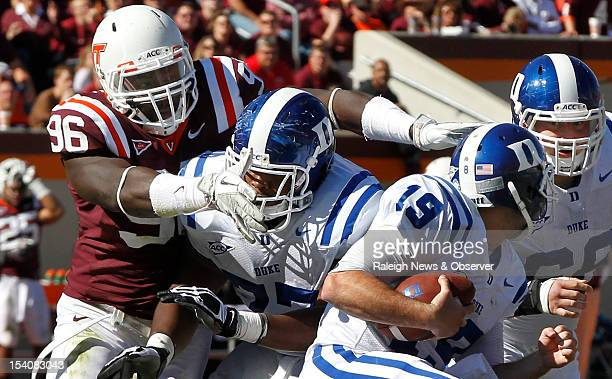Virginia Tech defensive end Corey Marshall goes over Duke guard Laken Tomlinson to sack quarterback Sean Renfree in the third quarter of play The...