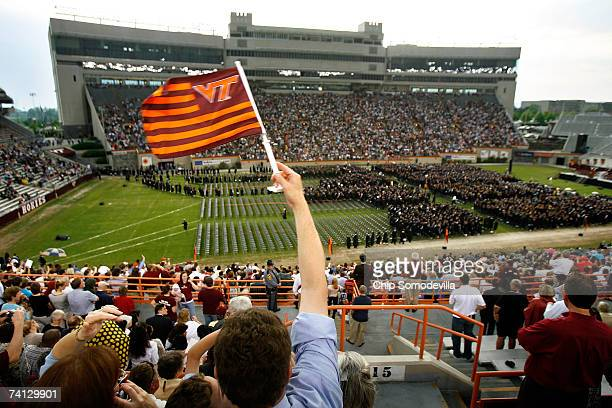 Virginia Tech flag is waved as about 2500 graduates file into the commencement ceremony at Lane Stadium on the Virginia Tech University campus May 11...