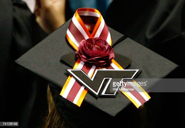 Virginia Tech graduate student displays a memorial ribbon on the top of her mortarboard cap during commencement exercises for graduate students at...