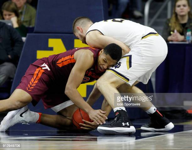 Virginia Tech Hokies forward Kerry Blackshear Jr battles with Notre Dame Fighting Irish forward Martinas Geben for control of the loose ball during...