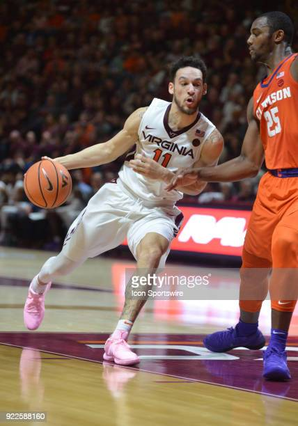 Virginia Tech Hokies guard Devin Wilson drives while being defended by Clemson Tigers forward Aamir Simms during a college basketball game on...