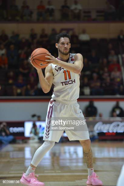 Virginia Tech Hokies guard Devin Wilson looks to pass the basketball during a college basketball game between the Virginia Tech Hokies and the...