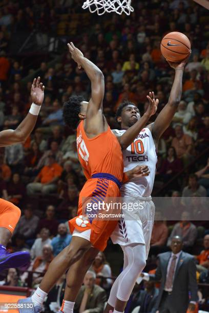 Virginia Tech Hokies guard Justin Bibbs goes up for a shot while being deffended by Clemson Tigers forward Elijah Thomas during a college basketball...