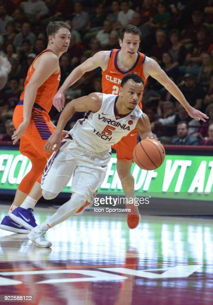 Virginia Tech Hokies guard Justin Robinson fast breaks down court during a college basketball game between the Virginia Tech Hokies and the Clemson...