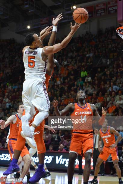Virginia Tech Hokies guard Justin Robinson goes in for a lay up during a college basketball game between the Virginia Tech Hokies and the Clemson...