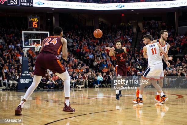 Virginia Tech Hokies Guard Wabissa Bede passes the ball to Virginia Tech Hokies Forward Kerry Blackshear Jr with Virginia Cavaliers Guard Ty Jerome...