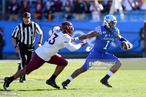 Virginia Tech Hokies linebacker Rayshard Ashby chases Kentucky Wildcats quarterback Lynn Bowden Jr on the play during the Belk Bowl between the...