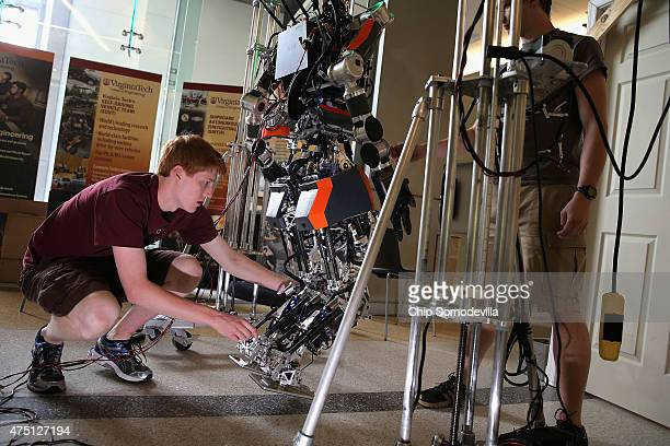 Virginia Tech mechanical engineering student Oliver EbelingKoning tests the ESCHER robot at the in the lobby of the Goodwin building on campus May 26...