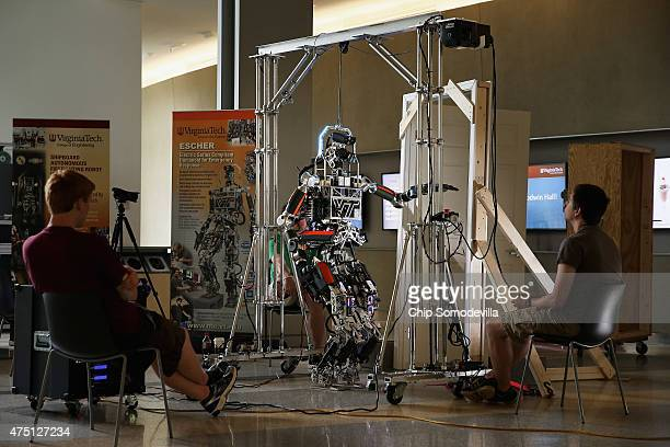 Virginia Tech mechanical engineering students test the ESCHER robot at the in the lobby of the Goodwin building on campus May 26 2015 in Blacksburg...