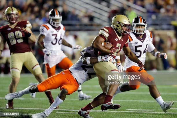 Virginia Tech safety Terrell Edmunds tackles Boston College running back AJ Dillon during a game between the Boston College Eagles and the Virginia...