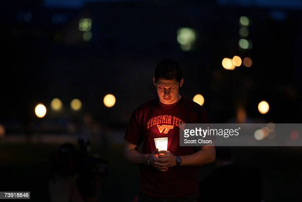 Virginia Tech sophmore Kenneth Erisman from Switzerland holds a candle near a memorial for the people killed in Monday's shooting spree April 18 2007...