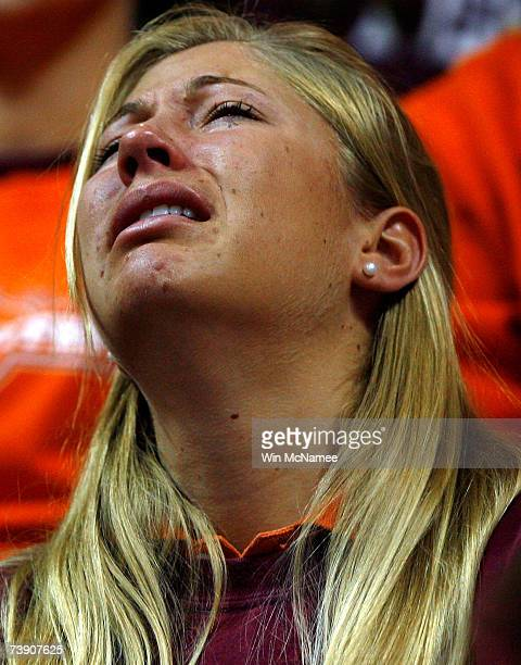Virginia Tech student cries during a convocation ceremony at Cassell Coliseum a day after a gunman shot and killed 32 people before turning the gun...