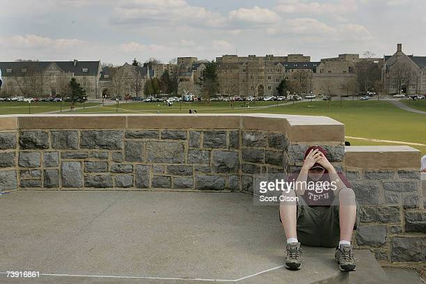 Virginia Tech student Jason Walters reflects near a memorial to the people killed in Monday's shooting spree April 18 2007 in Blacksburg Virginia...