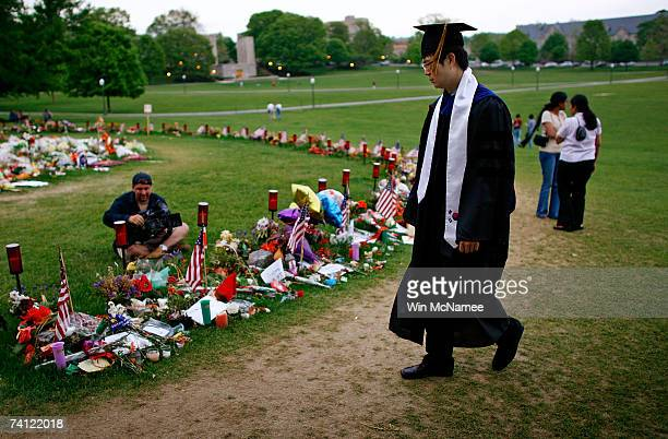 Virginia Tech student Kibum Kim pays his respects at a memorial to the 32 students and faculty killed in the Virginia Tech shootings at the Drill...