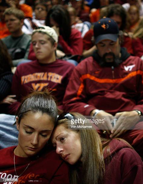 Virginia Tech students and parents comfort one another during a convocation ceremony at Cassell Coliseum a day after a gunman shot and killed 32...